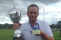 Steve poses with his two medals and trophy